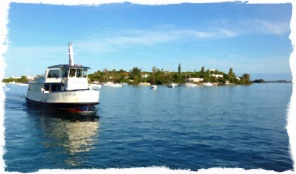 Morning commute. The early morning ferry Georgia approaches Darrell's Wharf, Bermuda.