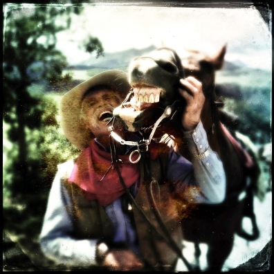 Roudy, a legendary cowboy in Telluride, Colorado, shares a laugh with his trusty steed.