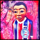 Hand-carved footballer, painted in the colours of Esporte Club Bahia, Salvador.